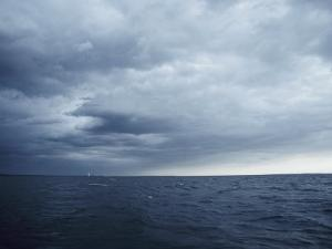 A Cloudy Sky Hangs over Lake Michigan by Todd Gipstein