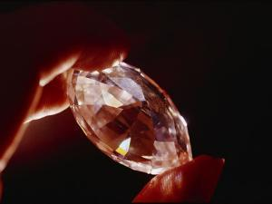 A Huge Nine-Carat Diamond Glistens with Light by Todd Gipstein