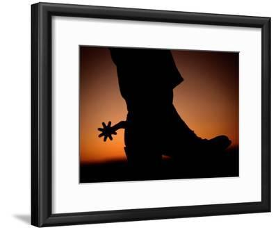 A Silhouette of a Boot and Spur