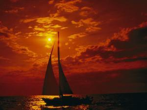 A Silhouette of a Sailboat on Lake Michigan by Todd Gipstein