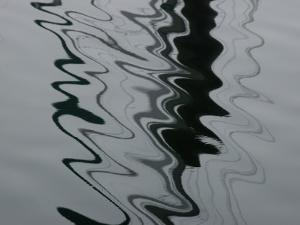 Abstract View of the Reflections of Pilings on Water by Todd Gipstein