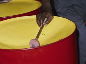 An Island Musician Plays a Brightly Colored Set of Steel Drums by Todd Gipstein