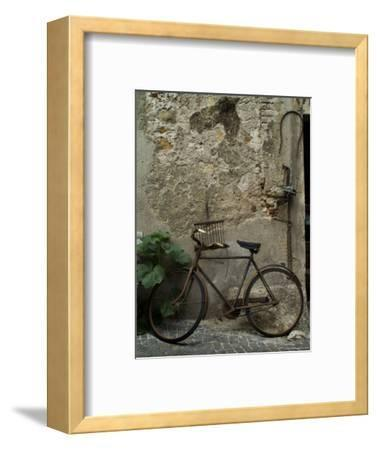 Antique Rusted Bicycle Leans against a Stone Wall, Asolo, Italy