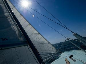 Bow of a Sailboat Sailing into the Sun on the Thames River by Todd Gipstein