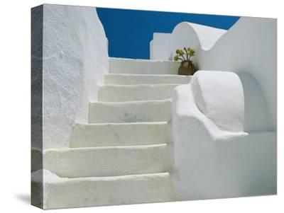 Bright White Stairs and Walls of One of Theras Cliff-Top Houses