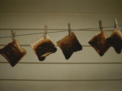 Burnt Toast Hanging on Clothesline by Todd Gipstein
