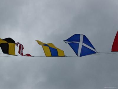 Close View of Nautical Flags Waving against a Cloudy Sky, Mystic, Connecticut