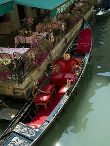 Fancy Gondola Parked in a Canal Next to a Restaurant, Venice, Italy by Todd Gipstein