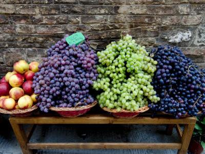 Grapes and Nectarines on a Bench at a Siena Market, Tuscany, Italy by Todd Gipstein