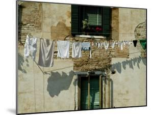 Laundry Hanging on a Line in Venice, Italy by Todd Gipstein