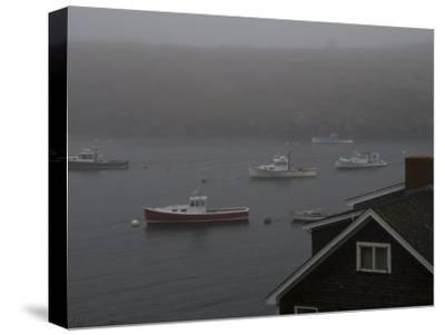 Lobster Boats on the Water Behind a House Gable in the Fog