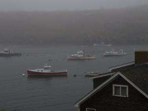 Lobster Boats on the Water Behind a House Gable in the Fog by Todd Gipstein