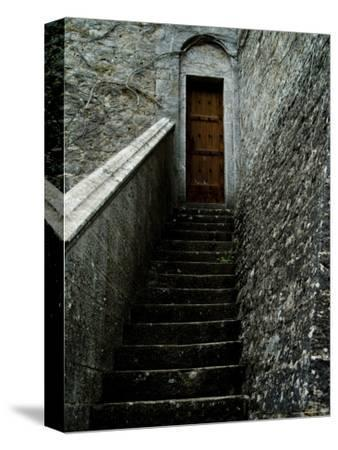 Narrow Stairway to a Wooden Door Inside the Grounds at Brolio Castle, Tuscany, Italy