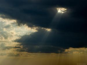 Rays of the Sun Piercing Through the Clouds by Todd Gipstein