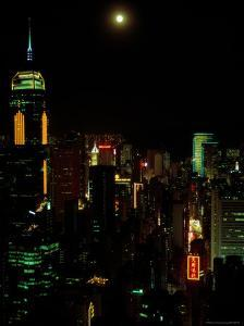 The Moon over the City Lights of Hong Kong by Todd Gipstein