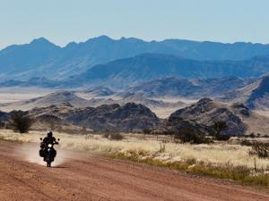 Motorbike Riding Through the Tarisberg Range by Todd Lawson