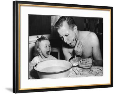 Toddler Girl Watching Father Shaving--Framed Photographic Print