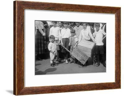 Toddler Holds a Small Soap Box Derby Vehicle--Framed Art Print