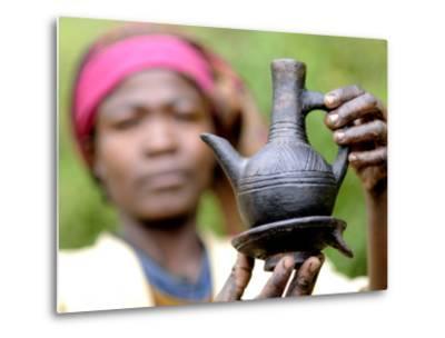 Dorze Woman with Black Coffee Pot