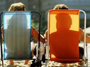 Man and Woman on Beach Chairs, Copacabana Beach by Tom Cockrem