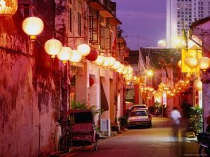 Narrow Street in Chinatown Decorated with Lanterns, Melaka, Malaysia by Tom Cockrem