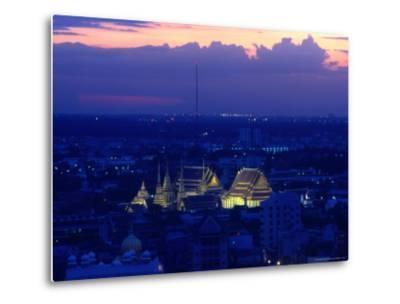 Wat Pho Lit Up at Night and City Buildings, Bangkok, Thailand
