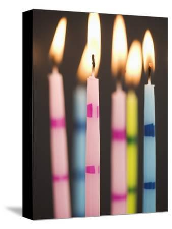 Six Lit Birthday Candles