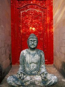 Buddha at Ornate Red Door, Ubud, Bali, Indonesia by Tom Haseltine