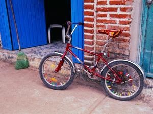 Children's Bicycle in Puerto Vallarta, The Colonial Heartland, Mexico by Tom Haseltine