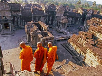 Monks Overlook Angkor Wat, Cambodia by Tom Haseltine