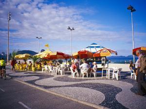 People Enjoying a Meal Near Copacabana Beach, Rio De Janeiro, Brazil by Tom Haseltine
