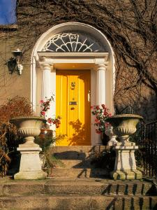 Stairs Leading to Bright Yellow Door, Dublin, Ireland by Tom Haseltine