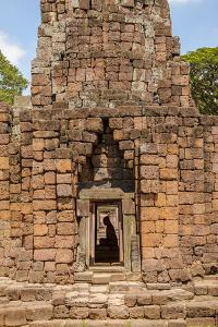 Thailand. Phimai Historical Park. Ruins of ancient Khmer temple complex. Buddha statue. by Tom Haseltine