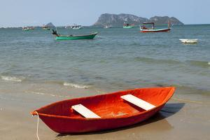 Thailand, Prachuap Khiri Khan. Ao Manao beach. Small colorful rowboats pulled up on the beach. by Tom Haseltine