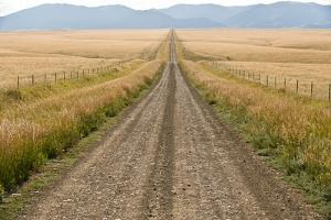 A Road Cuts Through a Prairie in the Crazy Mountains by Tom Murphy