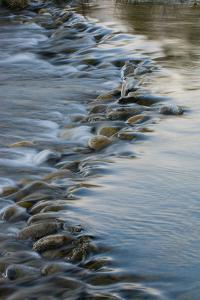 A Time Exposure of the Snake River Flowing over Rocks by Tom Murphy