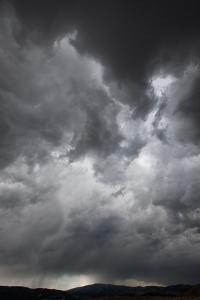 Heavy, Dark Storm Clouds over Yellowstone National Park by Tom Murphy
