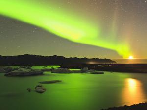 Aurora Borealis and Moon over Icebergs, Jokulsarlon and Breidamerkurjokull, Iceland by Tom Norring