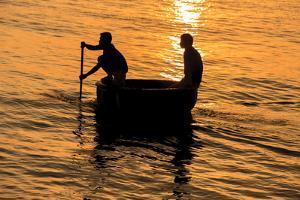 Fisherman Landing the Night Catch. Vietnam, Indochina by Tom Norring