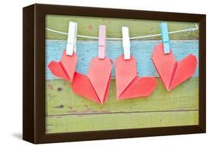 Paper Heart Hanging On The Clothesline. On Old Wood Background by tomgigabite