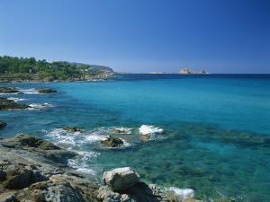 Distant View to the Ile De La Pietra, across Calm Turquoise Sea from Ile-Rousse, Corsica, France by Tomlinson Ruth