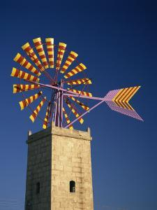 Windmill with Sails in the Colours of the Mallorcan Flag, Mallorca, Balearic Islands, Spain by Tomlinson Ruth