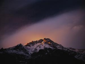 At sunset, wind scours the upper reaches of Nanga Parbat by Tommy Heinrich