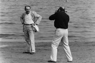 Tonino Guerra Poses before a Photographer at the Seaside--Photographic Print