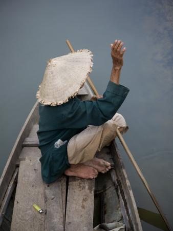 Local Man in Traditional Vietnamese Hat