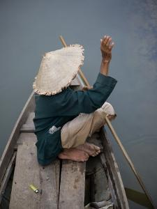 Local Man in Traditional Vietnamese Hat by Tony Burns