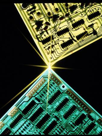Two Circuit Boards Meeting At a Spot of Light.