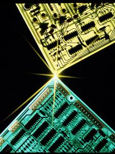 Two Circuit Boards Meeting At a Spot of Light. by Tony Craddock