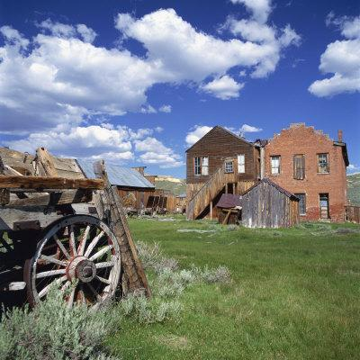 Old Farm Wagon and Derelict Wooden and Brick Houses at Bodie Ghost Town, California, USA