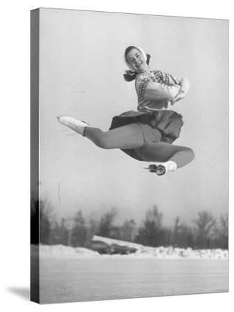 Barbara Ann Scott Smiling as She Leaps in Air on Skates at World Figure Skating Championship
